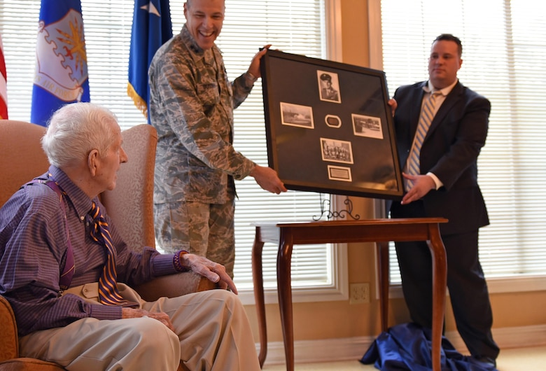 U.S. Air Force Maj. Gen. Thomas Bussiere, 8th Air Force commander, presents 93-year-old World War II veteran Raymond Odom with his dog tags at Arbor Rose Assisted Living Facility in Farmerville, La., Feb. 2, 2017. Odom was assigned to the 8th Air Force during WWII, and was presented his dog tags that were misplaced in 1945. The dog tags, found in England, made their way across the pond to Barksdale Air Force Base to be presented to Odom during an 8th Air Force 75th Anniversary official ceremony. (U.S. Air Force photo by Senior Airman Erin Trower)