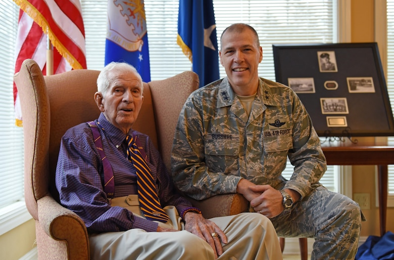 U.S. Air Force Maj. Gen. Thomas Bussiere, 8th Air Force commander, takes a photo with 93-year-old World War II veteran Raymond Odom during Odom's dog tag presentation at Arbor Rose Assisted Living Facility in Farmerville, La., Feb. 2, 2017. Odom was assigned to the 8th Air Force during WWII, and was presented his dog tags that were misplaced in 1945. The dog tags, found in England, made their way across the pond to Barksdale Air Force Base to be presented to Odom during an 8th Air Force 75th Anniversary official ceremony. (U.S. Air Force photo by Senior Airman Erin Trower)