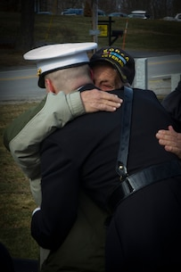 Newly-commissioned 2nd Lt. Charles Valenza, gratuate of University of New Hampshire, hugs his grandfather, a Korean War veteran, following his commissioning ceremony, Jan. 14, 2017. Valenza commissioned through the Platoon Leaders Course, where college students attend Officer Candidate School during their college summers and commisson upon graduation.