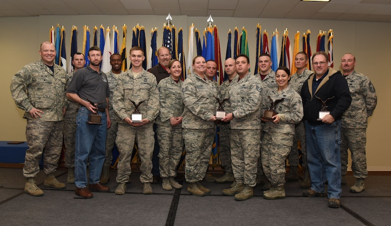 Col. Matthew Dillow, 90th Missile Wing vice commander, and Chief Master Sgt. Kristian Farve, 90th Operations Group superintendent, pose with the wing's fourth quarter award winners at F.E. Warren Air Force Base, Wyo., Feb. 3, 2017. The wing held a celebration for all the nominees and presented the awards to the winners during a ceremony. (U.S. Air Force photo by Airman 1st Class Breanna Carter)
