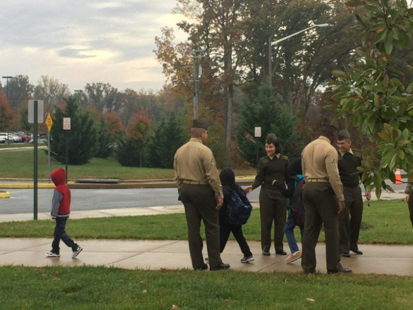 Marines braving the rain at Thornburg Middle School.