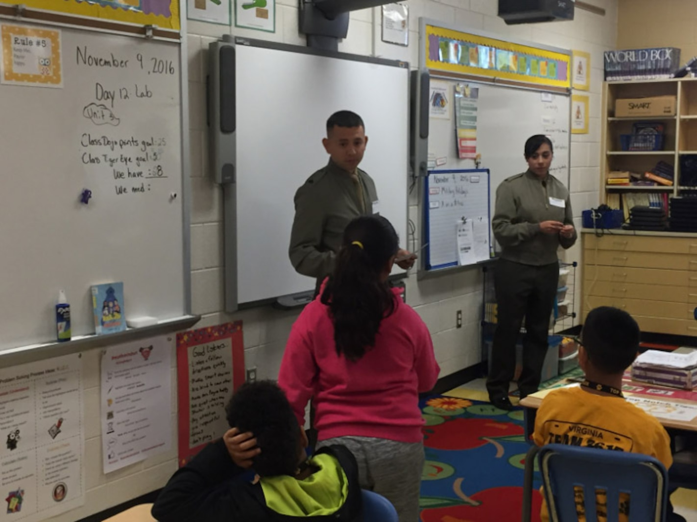 Marines helping in the classroom at Triangle Elementary School