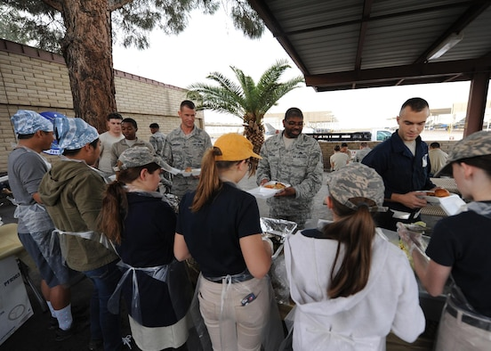 Airmen and their families receive a free meal from the 56th Fighter Wing chaplain office at the monthly flight line feast, Feb. 2, 2017 at Luke Air Force Base, Ariz. In addition to community outreach events, the chaplains office is available to Airmen for religious guidance, confidential counseling or just for someone to talk to. (U.S. Air Force photo by Airman 1st Class Caleb Worpel)