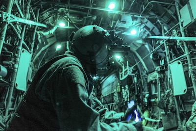 Air Force Tech. Sgt. Nathan Schultz waits to secure a load of cargo in a C-130H Hercules at Qayyarah Airfield West, Iraq, Feb. 3, 2017. Airmen delivered 30,000 pounds of cargo to aide in the fight against the Islamic State of Iraq and Syria. Air Force photo by Senior Airman Jordan Castelan