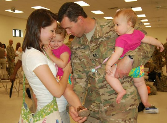 Army Reserve Capt. Richard Locklair says good-bye to his family prior to deployment in August 2013.  Courtesy photo