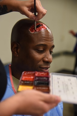 "Master Sgt. Al Jervier, 335th Training Squadron flight chief, has moulage applied to his head during a moulage training session at Allee Hall Jan. 18, 2017, on Keesler Air Force Base, Miss. The session was held to teach volunteers how to apply moulage on exercise ""casualties"" to provide emergency responders with a more realistic training experience. (U.S. Air Force photo by Kemberly Groue)"