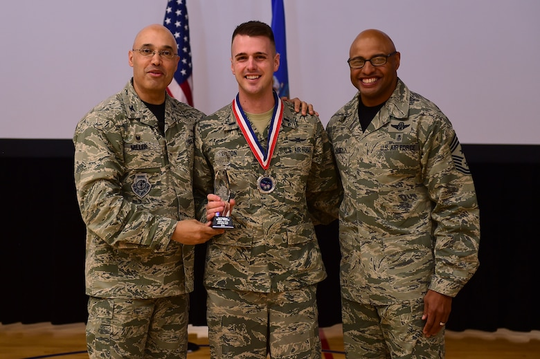 1st Lt. Walter Wilson, 460th Operations Group, center, receives the Company Grade Officer of the Year Award, from Col. David Miller Jr., 460th Space Wing commander, and Chief Master Sgt. Rod Lindsey, 460th SW command chief, Feb. 3, 2017, at the annual awards on Buckley Air Force Base, Colo. The annual awards is a ceremony that recognizes the significant achievements, dedication and skill of the military and civilian members of the 460th SW. (U.S. Air Force photo by Airman Jacob Deatherage/Released)