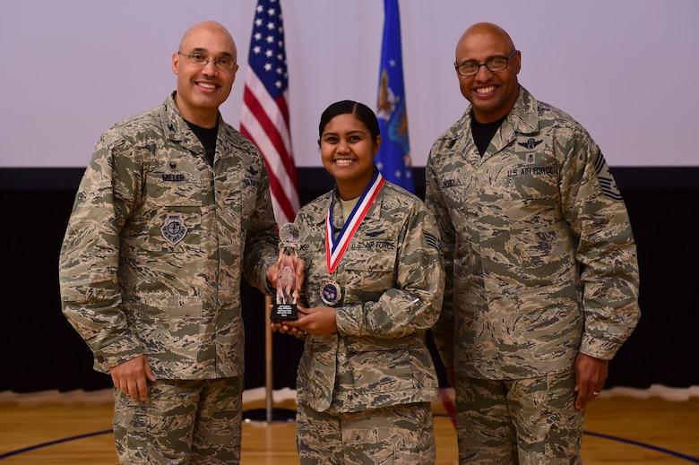 Staff Sgt. Ana Afonso, 460th Operations Group, receives the NCO of the Year Award, from Col. David Miller Jr., 460th Space Wing commander, and Chief Master Sgt. Rod Lindsey, 460th SW command chief, Feb. 3, 2017, at the annual awards on Buckley Air Force Base, Colo. The annual awards is a ceremony that recognizes the significant achievements, dedication and skill of the military and civilian members of the 460th SW. (U.S. Air Force photo by Airman Jacob Deatherage/Released)