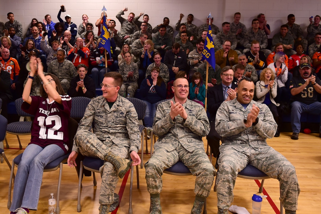 Buckley leadership cheer on the 460th Mission Support Group during the spirit competition Feb. 3, 2017, at the annual awards on Buckley Air Force Base, Colo. The annual awards is an award ceremony that recognizes the significant achievements, dedication and skill of the military and civilian members of the 460th Space Wing. (U.S. Air Force photo by Airman Jacob Deatherage/Released)