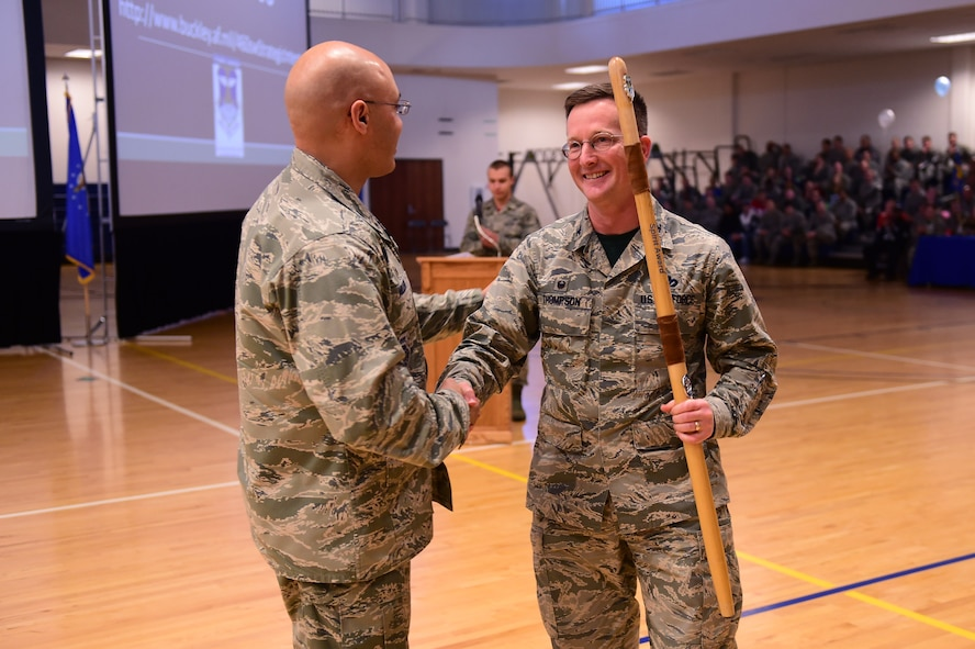 Col. David Miller Jr., 460th Space Wing commander, left, shakes hands with Col. Shawn Thompson, 460th Mission Support Group commander, right, Feb. 3, 2017, after handing over the spirit stick at the annual awards on Buckley Air Force Base, Colo. The spirit stick is given to the unit that has shown significant work ethic, accomplishments and spirit. (U.S. Air Force photo by Airman Jacob Deatherage)