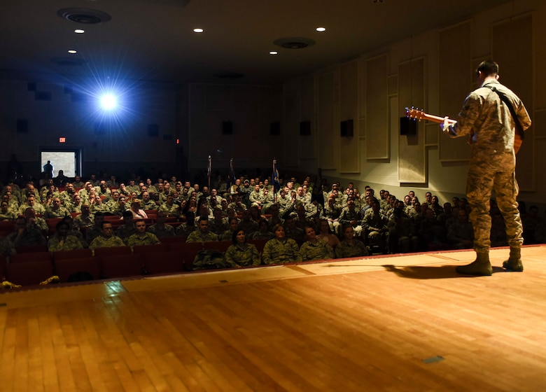 """Senior Airman James Pratt, a heavy equipment operator assigned to the 28th Civil Engineer Squadron, performs John Mayer's """"Age of Worry"""" in front of the 28th Mission Support Group inside the base theater during their annual awards ceremony, Jan. 26, 2017, at Ellsworth Air Force Base, S.D. Four days later, Pratt was announced the Air Force Entertainer of the Year and was congratulated by Col. Gentry Boswell, the commander of the 28th Bomb Wing, in a coining ceremony. (U.S. Air Force photo by Airman 1st Class Randahl J. Jenson)"""