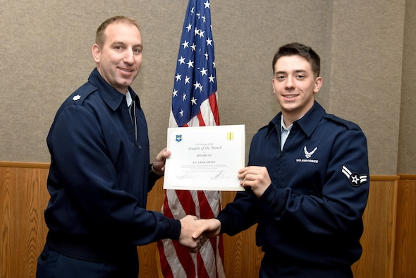 U.S. Air Force Lt. Col. Jason Kulchar, 315th Training Squadron director of operations, presents the 315th Training Squadron Student of the Month award for January 2017 to Airman 1st Class Craig Irvin, 315th TRS student, in the Brandenburg Hall on Goodfellow Air Force Base, Texas, Feb. 3, 2017. (U.S. Air Force photo by Staff Sgt. Joshua Edwards/Released)