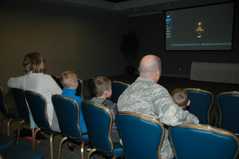 "The Mizell family watches an Atlas V 401 rocket successfully lift off Jan. 20 from Cape Canaveral Air Force Station, Florida, carrying the third Space Based Infrared Systems Geosynchronous Earth Orbiting satellite into orbit during an SMC Presents ""Launch and Learn"" session in the Gordon Conference Center at Los Angeles Air Force Base in El Segundo, California. (U.S. Air Force photo/Jim Spellman)"