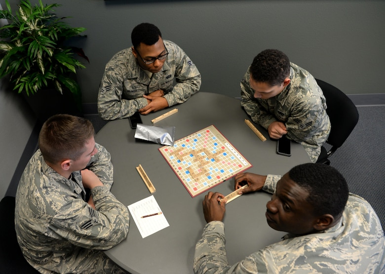 Airmen participate in a game of scrabble at the California CAfé at the Beale Community Activity Center, Feb. 3, 2017, at Beale Air Force Base, California. The CAFé lounge also offers free coffee, Wi-Fi, and a full surround sound projection screen. (U.S. Air Force photo/ Staff Sgt. Bobby Cummings)
