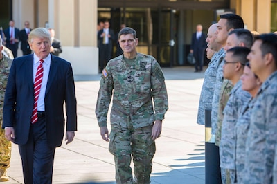 President Donald J. Trump and Army Gen. Joseph L. Votel, commander of U.S. Central Command, spend a few minutes with troops on their way to a news briefing at MacDill Air Force Base, Fla., Feb. 6, 2017. President Trump visited Centcom headquarters to discuss issues relevant to the command's area of responsibility. U.S. Central Command photo by Marine Corps Sgt. Alan Belser