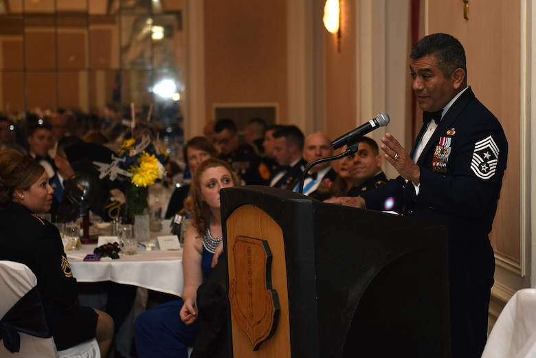 U.S. Air Force Retired Chief Master Sgt. Gerardo Tapia, Annual Awards guest speaker, delivers a speech about the 'one degree' that defines the annual award nominees during the Annual Awards Banquet at the Cactus Hotel in San Angelo, Texas, Feb. 3, 2017. The 17th Training Wing Command presented a 200 dollar check to Tapia for the Air Force Enlisted Village. (U.S. Air Force photo by Airman 1st Class Caelynn Ferguson/Released)