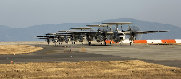 Five U.S. Navy E-2D Advanced Hawkeyes with Carrier Airborne Early Warning Squadron (VAW) 125, land at Marine Corps Air Station Iwakuni, Japan, Feb. 2, 2017. VAW-125 arrived at MCAS Iwakuni from Naval Station Norfolk, Va. The E-2D Advanced Hawkeye is equipped with the most advanced airborne radar in the world, possessing systems which increase the capabilities to defend Japan and provide security in the Indo-Asia-Pacific region. (U.S. Marine Corps photo by Lance Cpl. Jacob A. Farbo)