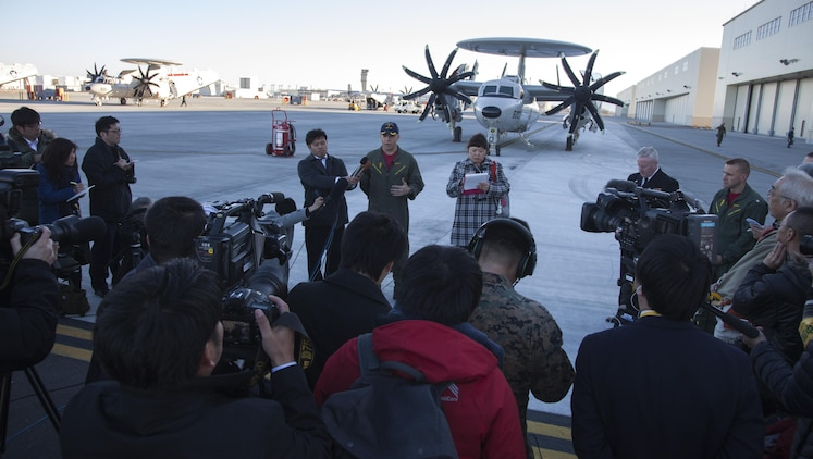U.S. Navy Cmdr. Daniel Prochazka, commanding officer of Carrier Airborne Early Warning Squadron (VAW) 125, addresses the local media during a press conference upon arrival to Marine Corps Air Station Iwakuni, Japan, Feb. 2, 2017. VAW-125 arrived at MCAS Iwakuni, from Naval Station Norfolk, Va. The E-2D Advanced Hawkeye is equipped with the most advanced airborne radar in the world, possessing systems which increase the capabilities to defend Japan and provide security in the Indo-Asia-Pacific region. (U.S. Marine Corps photo by Cpl. James A. Guillory)