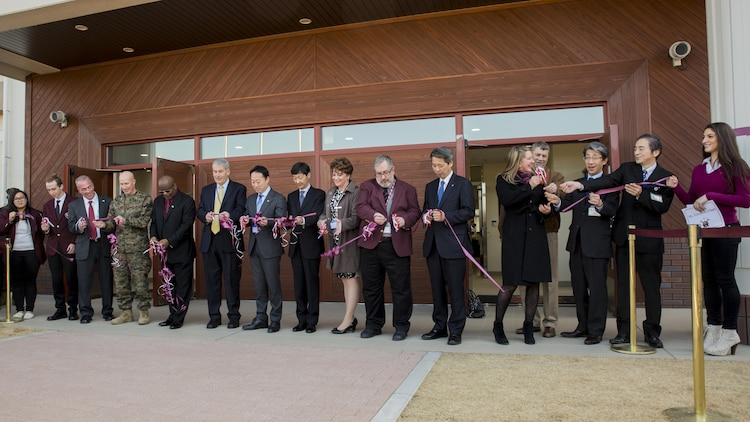 Students and staff, service members and civilian personnel cut ribbons during the Matthew C. Perry High School ribbon-cutting ceremony at Marine Corps Air Station Iwakuni, Japan, Feb. 3, 2017. The new 165,000 square foot high school is located next to the Kawashimo housing area provides improved security, resources and opportunities for students and staff. U.S. Marine Corps Col. Richard F. Fuerst, commanding officer of MCAS Iwakuni, Lorenzo Brown, principal of M.C. Perry High School, Jeffrey Carr, assistant principal of M.C. Perry High School, Yoshihiko Fukuda, mayor of Iwakuni City, and Iwakuni officials conducted the ribbon-cutting ceremony, signifying the grand opening of the new facility. (U.S. Marine Corps photo by Cpl. Aaron Henson)