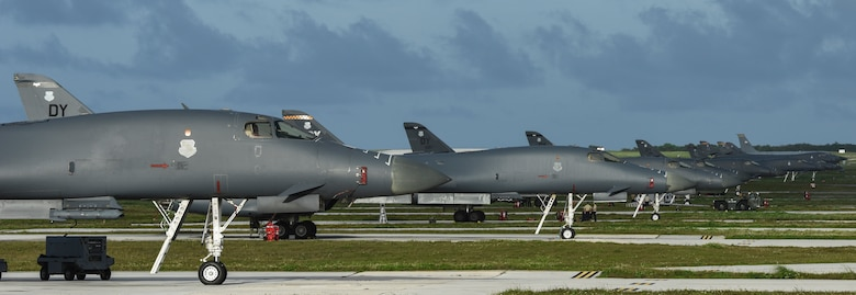 Twelve U.S. Air Force B-1B Lancers assigned to the 9th Expeditionary Bomb Squadron, deployed from Dyess Air Force Base, Texas, and the 34th EBS, assigned to Ellsworth Air Force Base, S.D., sit beside one another on the flightline Feb. 6, 2017, at Andersen AFB, Guam. The B-1s are highly versatile, multi-mission weapon systems capable of tracking, targeting and engaging moving vehicles as well as allowing aircrew to receive targeting data from the Combined Air Operations Center or other command and control assets to strike emerging targets rapidly and efficiently. The U.S. military has maintained a deployed strategic bomber presence in the Pacific since March 2004, which has contributed significantly to regional security and stability. (U.S. Air Force photo by Tech. Sgt. Richard P. Ebensberger/Released)