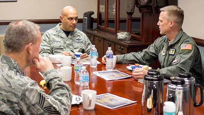 Brig. Gen. Brian Robinson (center), Air Mobility Command director of operations, meets with Col. Kelly Holbert (right), 43d Air Mobility Operations Group commander, and Chief Master Sgt. James Cope, 43d AMOG superintendent, during a brief visit to Pope Field Feb. 3. Robinson attended the Joint Forcible Entry Readiness Symposium at Fort Bragg and met with 43d AMOG leadership, where he discussed AMC's ongoing support for the joint mission at Pope Field, and for the 43d AMOG's mission of 24/7 operational mission execution, persistent Joint Airborne / Air Transportability Training, Pope Airmen support and Global Response Force Readiness.