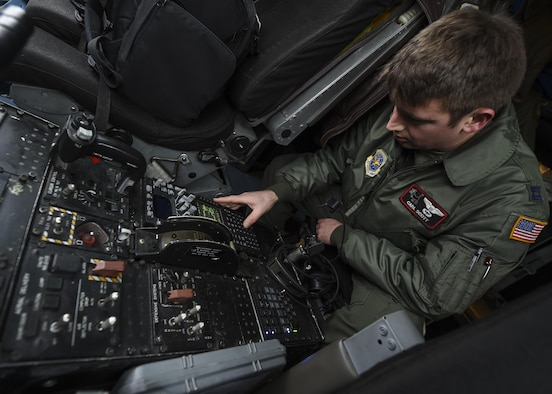 U.S. Air Force Capt. Carl Scott, 41st Airlift Squadron C-130J pilot and tactics officer, prepares a C-130J for its first flight using Block 8.1 upgrades Feb. 3, 2017, at Little Rock Air Force Base, Ark. The Block 8.1 upgrade enhances GPS capabilities, communications systems, updated friend-or-foe identification and allows the C-130J to comply with worldwide air traffic management regulations. (U.S. Air Force photo/Senior Airman Harry Brexel)