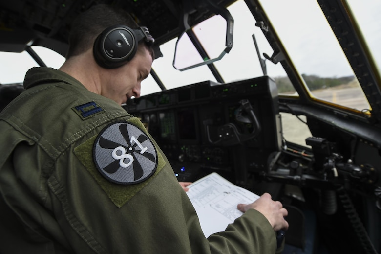 U.S. Air Force Capt. Kyle Gauthier, 61st Airlift Squadron C-130J pilot and flight commander, reviews a preflight checklist Feb. 3, 2017, at Little Rock Air Force Base, Ark. His shoulder patch indicates the C-130J Block 8.1 system upgrade and expansion. Gauthier, along with a team of 19th Airlift Wing Airmen, conducted Air Mobility Command's first C-130J flight with the upgrade. (U.S. Air Force photo/Senior Airman Harry Brexel)