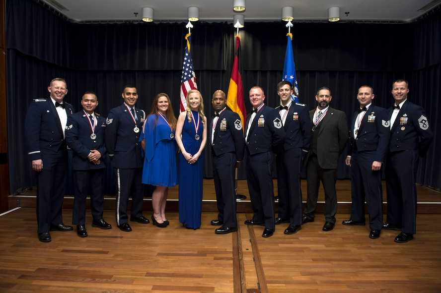 Annual award winners from the 52nd Fighter Wing pose for a group photo with wing leadership during the 2016 Annual Award banquet at Spandahlem Air Base, Germany on Feb. 3, 2016. The banquet began with a ceremony to highlight all nominees and ended with the recognition of 13 winners. (U.S. Air Force photo by Airman 1st Class Preston Cherry)