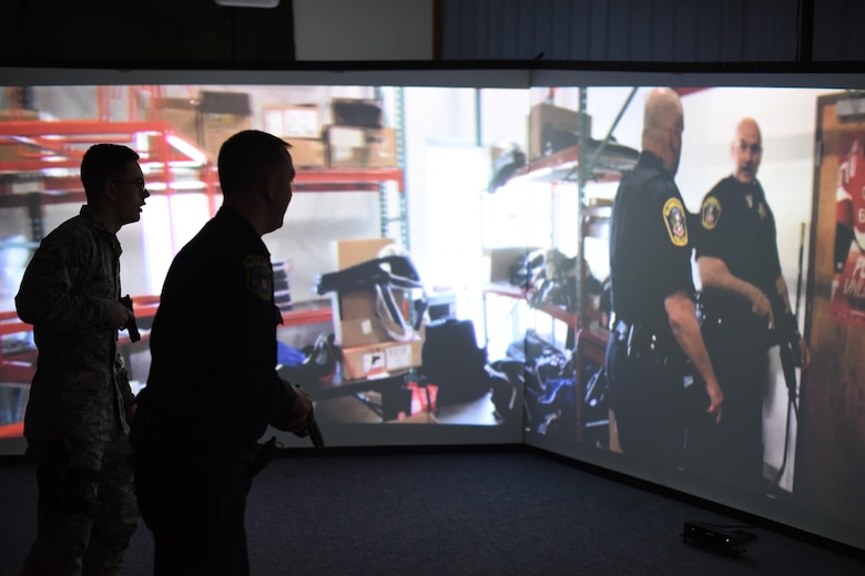 Airman 1st Class Alexander Morales, left, and Officer Ryan Lee, 22nd Security Forces Squadron patrolmen, use the Milo Range Training System, Feb. 1, 2017, at McConnell Air Force Base, Kan. The new training system has three interactive screens designed to improve situational awareness, tactics and weapon familiarization through various scenarios. (U.S. Air Force photo/Senior Airman Christopher Thornbury)