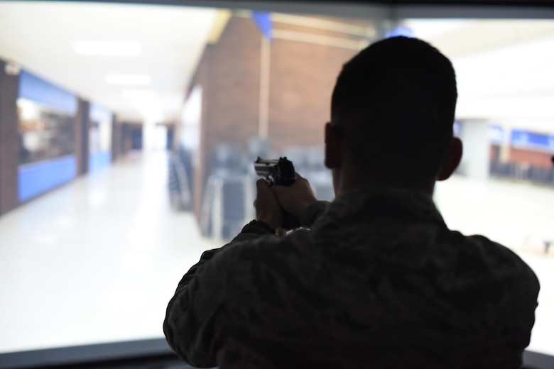 Airman 1st Class Alexander Morales, 22nd Security Forces Squadron patrolman, clears a hall during an active-shooter exercise with the Milo Range Training System, Feb. 1, 2017, at McConnell Air Force Base, Kan. It is the 22nd Security Forces Squadron's responsibility to respond if or when a dire situation arises. To ensure the best result unfolds, they invested in their capabilities by bringing the new training system to the unit. (U.S. Air Force photo/Senior Airman Christopher Thornbury)