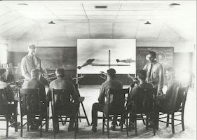Circa 1918, students at Scott Field learn to aim the 'Lewis Gun', a World War I-era light machine gun that was widely used on aircraft in both World Wars.