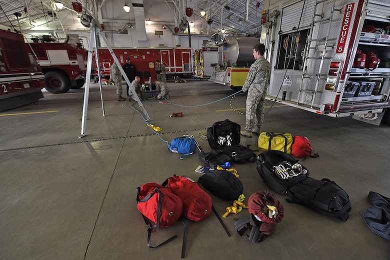 "92nd Civil Engineer Squadron firefighters work together to build a 'z'-rig rope system during a confined spaces training Jan. 27, 2017, Fairchild Air Force Base, Wash. Ropes and knots are an important aspect of fire protection training and ensure Fairchild firefighters are always ""rescue ready.""(U.S. Air Force photo/Senior Airman Mackenzie Richardson)"