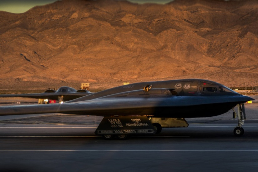 Two B-2 Spirit stealth bombers assigned to the 509th Bomb Wing taxi in preparation for takeoff during Deliberate Strike Night at Nellis Air Force Base, Nev., June 16, 2016. Two B-2s departed Whiteman Air Force Base, Mo., for a transatlantic flight to Libya on Jan. 18, 2017, in what would become the B-2's first combat mission since Operation Odyssey Dawn in 2011. Air Force photo by Airman 1st Class Kevin Tanenbaum