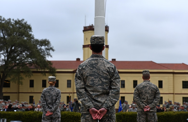 Bomber Airmen from across the country gather around the 2nd Bomb Wing flag pole for a retreat ceremony at Barksdale Air Force Base, La., Feb. 2, 2016. U.S. Air Force Maj. Gen. Thomas Bussiere, 8th Air Force commander, spoke at the retreat ceremony, which was followed by an in-trail formation of a B-1, B-2 and B-52 bomber flyover. The flyover took place as part of the 8th Air Force's 75th anniversary events. (U.S. Air Force photo by Senior Airman Erin Trower)