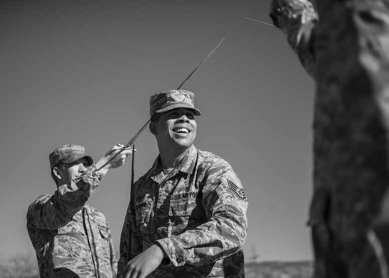 Staff Sgt. Maurice Coleman, the Steel Talons Honor Guard operations technician, instructs Steel Talons Honor Guard members on proper handling of a saber during a practice session at Heritage Park at Holloman Air Force Base, N.M., on Feb. 1, 2017. The Steel Talons Honor Guard was created to honor fallen members of the armed services, both past and present. To become a Steel Talons member, Airmen must complete their career development coursework, gain consent from their supervision and conform to the Air Force uniform and fitness standards. (U.S. Air Force photo by Airman 1st Class Alexis P. Docherty)