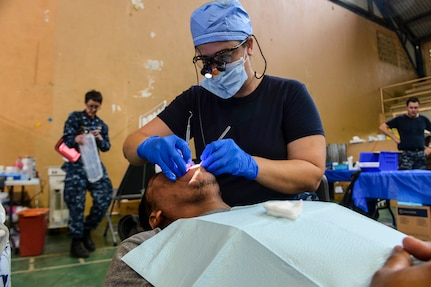 PUERTO BARRIOS, Guatemala (Feb. 3, 2017) -- Chief Hospital Corpsman Meagen Fahey, a native of Wakefield, N.H., assigned to Naval Dental Center Camp Lejeune, N.C., performs a cleaning on a host nation patient at the Continuing Promise 2017 (CP-17) medical site in Puerto Barrios, Guatemala. CP-17 is a U.S. Southern Command-sponsored and U.S. Naval Forces Southern Command/U.S. 4th Fleet-conducted deployment to conduct civil-military operations including humanitarian assistance, training engagements, and medical, dental, and veterinary support in an effort to show U.S. support and commitment to Central and South America. (U.S. Navy Combat Camera photo by Petty Officer 2nd Class Brittney Cannady)