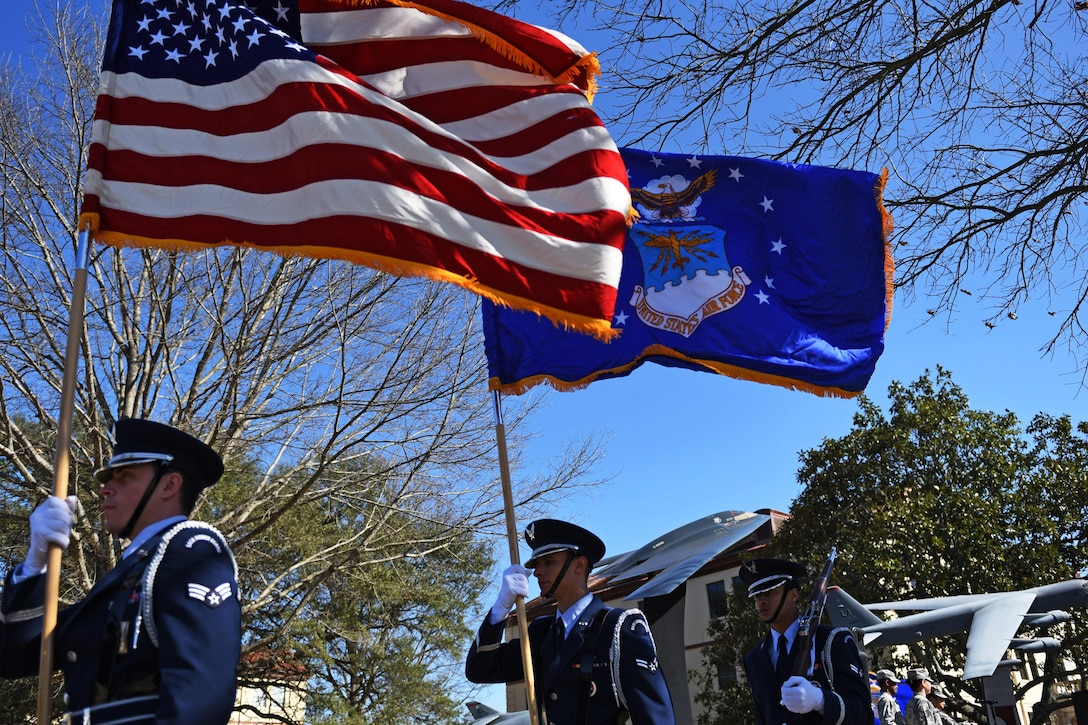 Barksdale Air Force Base honor guard members participate in a building dedication and cake cutting ceremony at Barksdale AFB, La., Feb. 2, 2017. On Feb. 1, the 8th Air Force celebrate its 75th diamond anniversary and hosted various events throughout the week to commemorate and honor its past, present and future Airmen. (U.S. Air Force photo by Senior Airman Erin Trower)