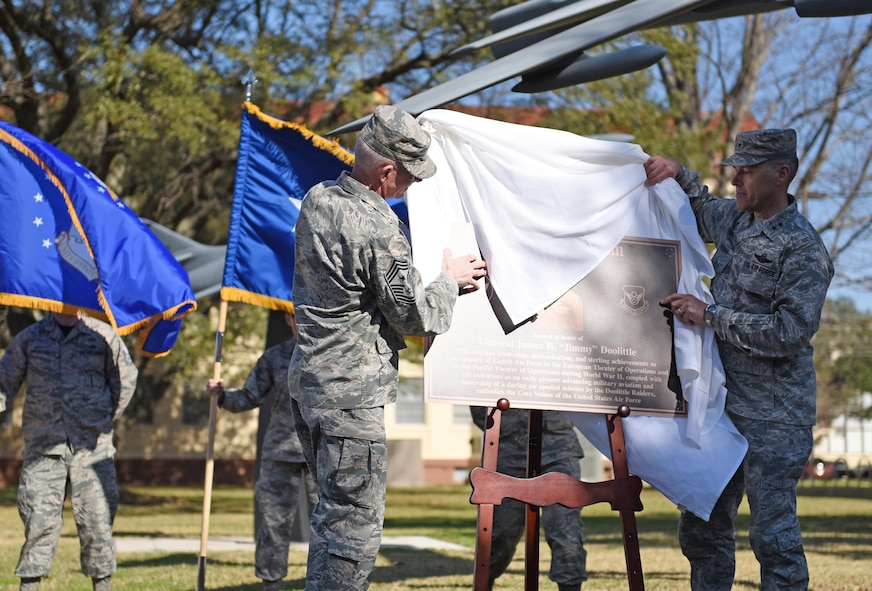 "Chief Master Sgt. Alan Boling, 8th Air Force command chief, and Maj. Gen. Thomas Bussiere, 8th AF commander, unveil a plaque during a building dedication ceremony at Barksdale Air Force Base, La., Feb. 2, 2017. The 8th AF headquarters building was dedicated to General James H. ""Jimmy"" Doolittle during a series of 8th AF 75th diamond anniversary events. On Feb. 1, the Eighth celebrated its 75th anniversary, and former and current ""Mighty Eighth"" Airmen from across the country came to Barksdale AFB to take part in the celebration. (U.S. Air Force photo by Senior Airman Erin Trower)"
