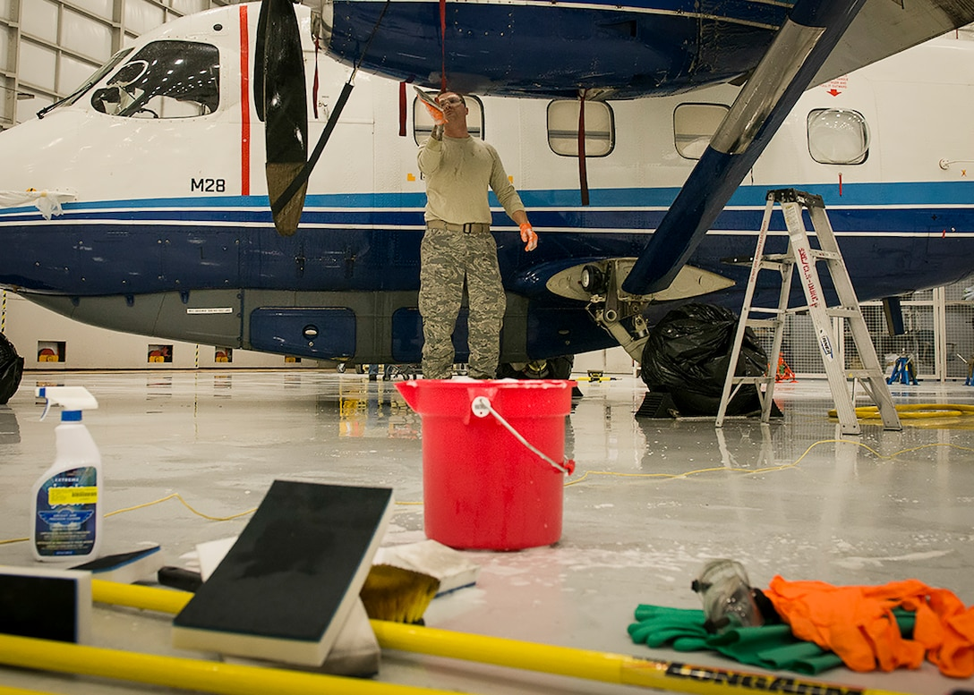 A 919th Special Operations Maintenance Group Airman washes a C-145 Skytruck at Duke Field, Fla.  (U.S. Air Force photo/Tech. Sgt. Jasmin Taylor)