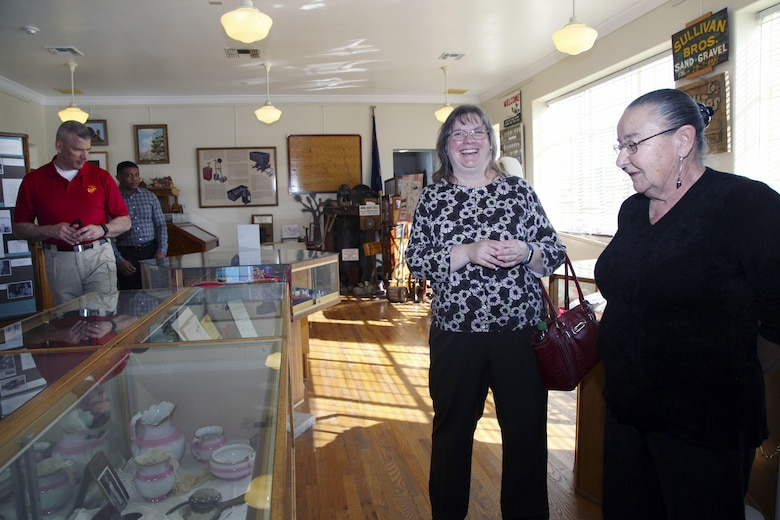 Brig. Gen. William F. Mullen III, Combat Center Commanding General, left, and Cpl. Ben Mills, driver, view items on display at the Old Schoolhouse Museum in Twentynine Palms, Calif., Jan. 31, 2017, as his wife, Vicki, shares a laugh with Twentynine Palms Historical Society volunteer Pat Rimmington. The general and his wife toured the facility with Sgt. Maj. Michael J. Hendges, Combat Center Sergeant Major; Mills; Jim Ricker, Combat Center Assistant Chief of Staff for Government and External Affairs; and Kristina Becker, Combat Center External Affairs Director. (Official Marine Corps photo by Kelly O'Sullivan/Released)