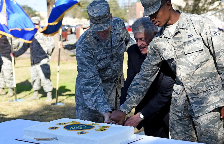 "Maj. Gen. Thomas Bussiere, 8th Air Force commander, participates in a cake cutting ceremony with a former 8th AF commander, Gen. James McCarthy, (retired), and Airman 1st Class De'Andre Pool, 608th Air Operations Center administration apprentice, at Barksdale Air Force Base, La., Feb. 2, 2017. Various events, such as a memorial run, building dedication, cake cutting ceremony, and a local organization sponsored gala, took place to honor and commemorate the former, present and future Airmen of the ""Mighty Eighth"". (U.S. Air Force photo by Senior Airman Erin Trower)"
