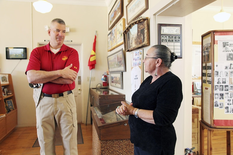 Brig. Gen. William F. Mullen III, Combat Center Commanding General, left, talks with Twentynine Palms Historical Society volunteer Pat Rimmington about local history during a tour of the Old Schoolhouse Museum in Twentynine Palms, Calif., Jan. 31, 2017. The general and his wife, Vicki, toured the facility with Sgt. Maj. Michael J. Hendges, Combat Center Sergeant Major; Cpl. Ben Mills, driver; Jim Ricker, Combat Center Assistant Chief of Staff for Government and External Affairs; and Kristina Becker, Combat Center External Affairs Director. (Official Marine Corps photo by Kelly O'Sullivan/Released)