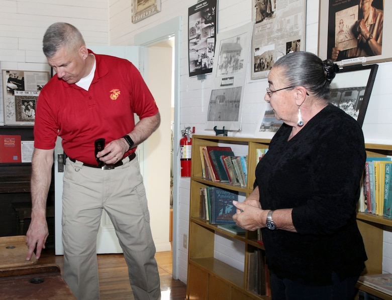 Brig. Gen. William F. Mullen III, Combat Center Commanding General, inspects a desk with Twentynine Palms Historical Society volunteer Pat Rimmington during a tour of the Old Schoolhouse Museum in Twentynine Palms, Calif., Jan. 31, 2017. Mullen and his wife, Vicki, toured the facility with Sgt. Maj. Michael J. Hendges, Combat Center Major; Cpl. Ben Mills, driver; Jim Ricker, Assistant Chief of Staff for Government and External Affairs; and Kristina Becker, Combat Center External Affairs Director. (Official Marine Corps photo by Kelly O'Sullivan/Released)