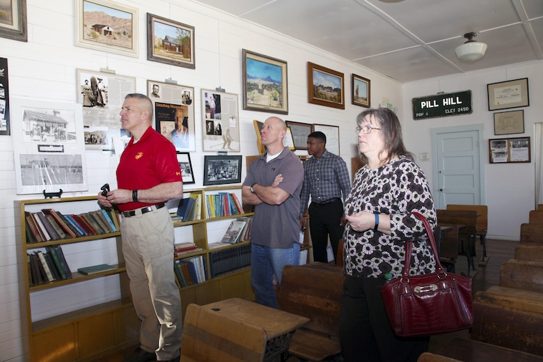 Brig. Gen. William F. Mullen III, Combat Center Commanding General, left; Sgt. Maj. Michael J. Hendges, Combat Center Sergeant Major; Cpl. Ben Mills, driver; and Vicki Mullen listen to Twentynine Palms Historical Society volunteer Pat Rimmington during a tour of the Old Schoolhouse Museum in Twentynine Palms, Calif., Jan. 31, 2017. The four toured the facility with Jim Ricker, Combat Center Assistant Chief of Staff for Government and External Affairs; and Kristina Becker, Combat Center External Affairs Director. (Official Marine Corps photo by Kelly O'Sullivan/Released)