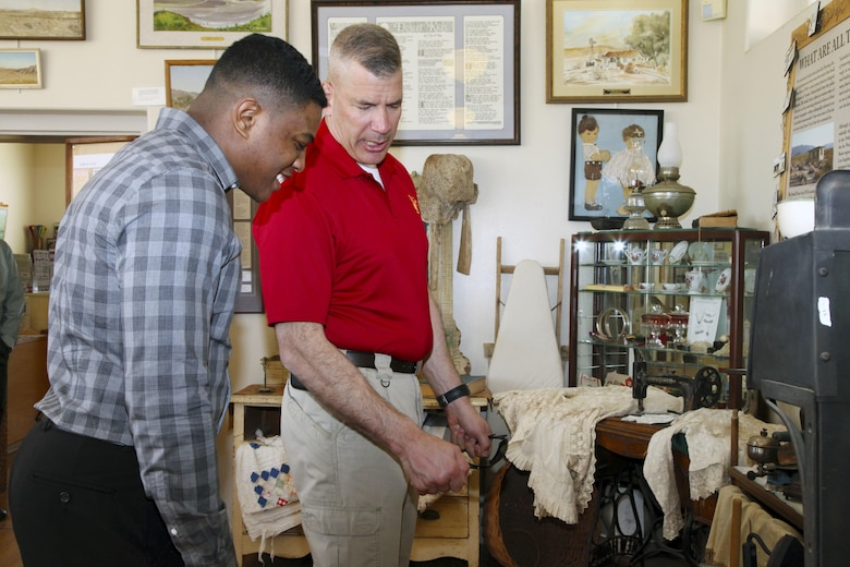 Brig. Gen. William F. Mullen III, Combat Center Commanding General, right, talks with his driver, Cpl. Ben Mills, about items used by early desert homesteaders during a tour of the Old Schoolhouse Museum in Twentynine Palms, Calif., Jan. 31, 2017. The general and his wife, Vicki, toured the facility with Sgt. Maj. Michael J. Hendges, Combat Center Sergeant Major; Mills; Jim Ricker, Combat Center Assistant Chief of Staff for Government and External Affairs; and Kristina Becker, Combat Center External Affairs Director. (Official Marine Corps photo by Kelly O'Sullivan/Released)