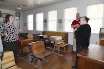 Vicki Mullen, left, and Brig. Gen. William F. Mullen III, Combat Center Commanding General, talk with Twentynine Palms Historical Society volunteer Pat Rimmington about local history during a tour of the Old Schoolhouse Museum in Twentynine Palms, Calif., Jan. 31, 2017. The general and his wife toured the facility with Sgt. Maj. Michael J. Hendges, Combat Center Sergeant Major; Cpl. Ben Mills, driver; Jim Ricker, Combat Center Assistant Chief of Staff for Government and External Affairs; and Kristina Becker, Combat Center External Affairs Director. (Official Marine Corps photo by Kelly O'Sullivan/Released)