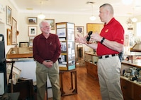 Brig. Gen. William F. Mullen III, Combat Center Commanding General, right, talks with Twentynine Palms Historical Society President Les Snodgrass, about local history during a tour of the Old Schoolhouse Museum in Twentynine Palms, Calif., Jan. 31, 2017. The general and his wife, Vicki, toured the facility with Sgt. Maj. Michael J. Hendges, Combat Center Sergeant Major; Cpl. Ben Mills, driver; Jim Ricker, Combat Center Assistant Chief of Staff for Government and External Affairs; and Kristina Becker, Combat Center External Affairs Director. (Official Marine Corps photo by Kelly O'Sullivan/Released)