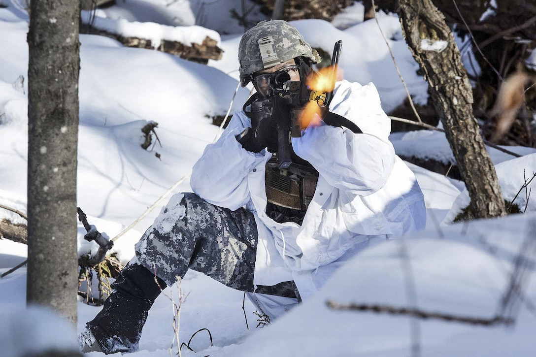 Army National Guard Staff Sgt. Jason Staff engages simulated opposing forces during winter training at Camp Ethan Allen Training Site, Vt., Jan. 31, 2017. Staff is an infantryman assigned to the Colorado National Guard's Company C, 1st Battalion, 157th Infantry Regiment. Air National Guard photo by Tech. Sgt. Sarah Mattison