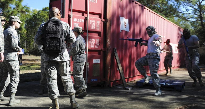A simulated robbery takes place during the Joint Contingency Contracting Officer Training Exercise at Hurlburt Field, Fla., Feb. 2, 2017. Air Commandos, left, were performing a routine commodity purchase when a group of simulated opposition forces robbed them at gunpoint. (U.S. Air Force photo by Airman Dennis Spain)