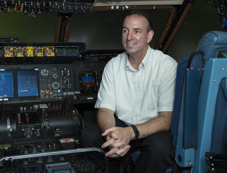 Retired Chief Master Sgt. Bryan Burns, 60th Operations Support Squadron, poses for a photo inside a C-5M Super Galaxy at Travis Air Force Base, Calif., June 6, 2016. Burns flew from McChord Air Force Base, Wash., to Travis AFB on July 9, 1986 in just two hours to be present for the birth of his son Matthew. Burns served 25 years in the U.S. Air Force and retired in 2007. (U.S. Air Force Photo by Heide Couch/Released)